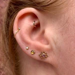 Naomi-Clayton-Piercing Ear-Yellow-Gold-Rook-Helix-Flat-Lobe-Upper-Cartilage-Gold-Chain-Naomi-Piercer-Obelisk-Body-Piercing-Fine-Jewelry-Renton-Washington