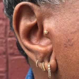 Naomi-Tragus-Ear-Star-Yellow-Gold--Naomi-Piercer-Obelisk-Body-Piercing-Fine-Jewelry-Renton-Washington