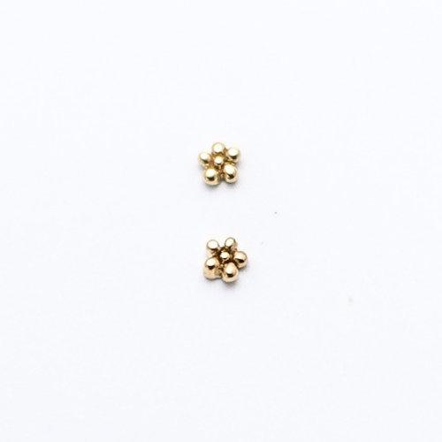 daisy-leroi-yellow-gold-Obelisk-body-piercing-renton-wa